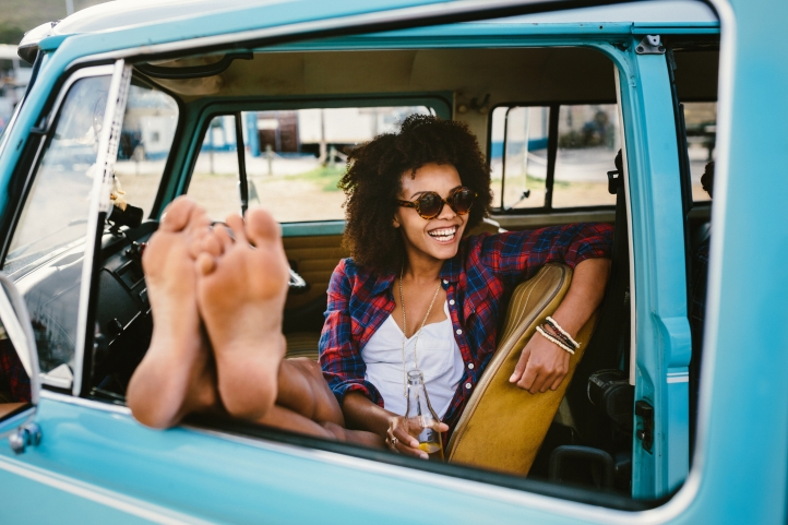 Girl barefoot in the car